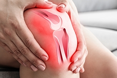 A person holding their knee with a medical illustration of the knee joint overlaid on top