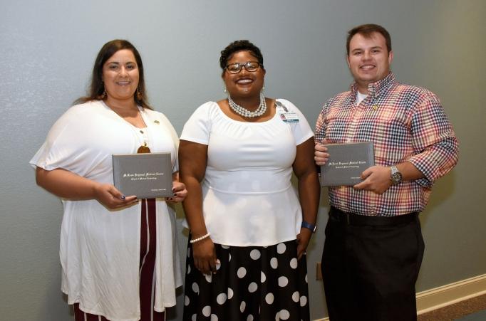 McLeod School of Medical Technology Program Director April Orange posing with two 2019 graduates