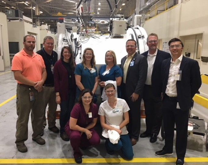 McLeod Radiology staff and GE Healthcare employees posing together after a tour of the MRI Plant in Florence