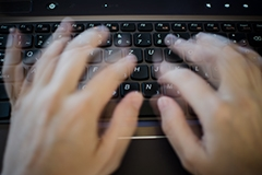 Fingers typing rapidly on a keyboard