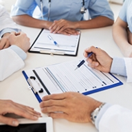 A group of doctors going over a patient chart together