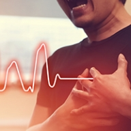 A man holding his chest in pain with a heart rate monitor graph flatlining